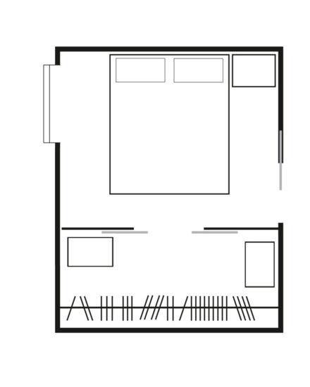 Soluzione con cabina armadio di fronte al letto
